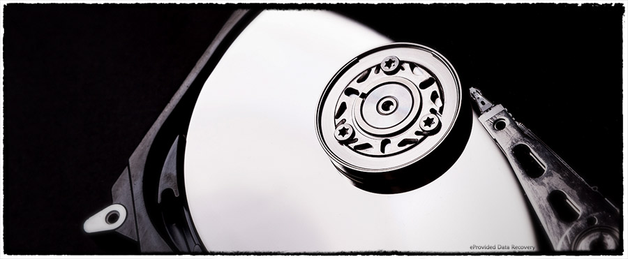 A Hard Drive Internals Photo. Inside a Hard Drive, Moving Parts, Heads and Platters.